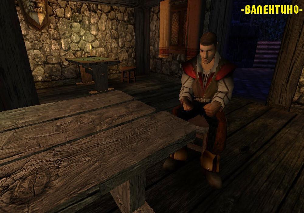 Валентино сидит за столом в таверне